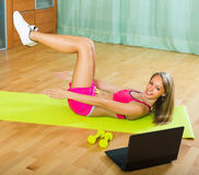 Girl working out with notebook Stock Photo