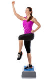 Girl is working out with stepper Stock Photo