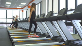 Girl working out in a treadmill at the gym stock video