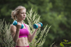 Girl working out Royalty Free Stock Images