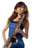 Girl in working overalls with sax Stock Photo