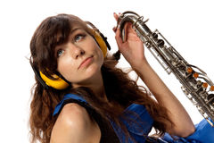 Girl in working overalls with sax Royalty Free Stock Photo