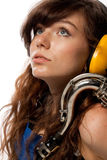 Girl in working overalls with sax Stock Images