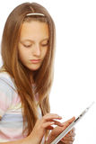 Girl working with the portable tablet computer Stock Photo