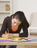 Girl Working on Project Royalty Free Stock Photos
