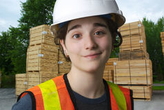 Girl working at the sawmill, construction wood industry Royalty Free Stock Photo