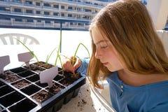 Girl working on seedling task outdoor royalty free stock image