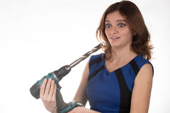 Girl with a working tool screwdriver laughing on a white backgro Royalty Free Stock Photo