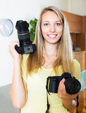 Girl working with two photocameras Royalty Free Stock Images