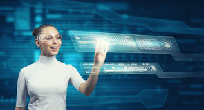Girl working with virtual screen Stock Photo