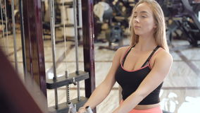 The girl workout with power simulator in the gym in 4K stock video