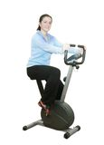 Girl workout on stationary bicycle Stock Photos