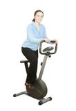 Girl workout on stationary bicycle Stock Photography