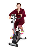 Girl workout on stationary bicycle Stock Image