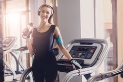 The girl after a workout on a treadmill is resting royalty free stock image
