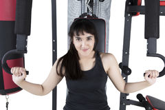 Girl workout with weights machine Royalty Free Stock Photography