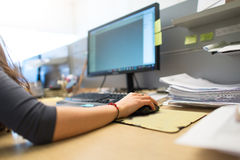 Girl works in commercial office with hand on the mouse Stock Photography