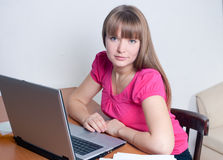 The girl works at the computer Royalty Free Stock Images