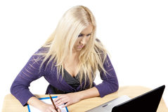 Girl works at a desk Stock Image