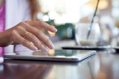 Girl works on the digital tablet, a small depth Stock Photography