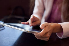 Girl works on the digital tablet, a small depth Stock Photos