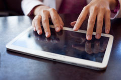 Girl works on the digital tablet, a small depth Stock Images