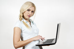 Girl works at a laptop Royalty Free Stock Image