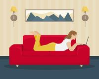 The girl works at the laptop lying on the couch. Home office. Flat illustration vector illustration