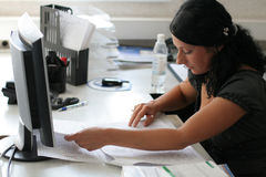 Girl works in office Royalty Free Stock Photos