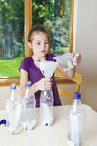 Girl works on Science Fair project Stock Photography