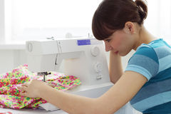 The girl works on sewing machine Stock Image