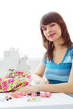 Girl works at sewing machine Royalty Free Stock Image