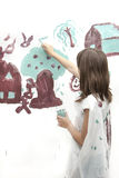 Girl works on simple painting. Stock Photos