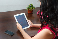 Girl works on the tablet Stock Photo