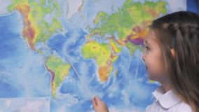 Girl with World Map in Classroom stock video