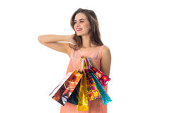Girl worth unscrewing my head to the side and holding a ranye packages isolated on white background Stock Photo