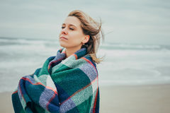 A girl wrapped in a blanket Royalty Free Stock Photos