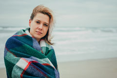 A girl wrapped in a blanket Royalty Free Stock Images