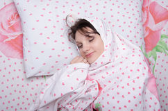 Girl wrapped in a blanket Stock Photography
