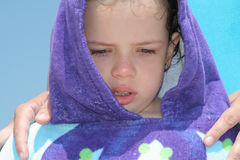 Girl wrapped in blue towel Royalty Free Stock Image