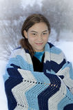 Girl Wrapped in Crocheted Blanket Stock Image