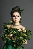 Girl Wrapped With Ivy Leaves Stock Image