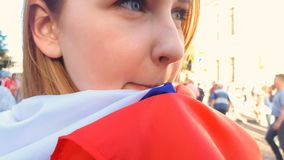 Girl wrapped in national flag standing among crowd, election campaign, politics. Stock photo royalty free stock photography