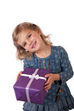 Young girl with a wrapped present stock photos