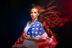 Girl wrapped in US flag Royalty Free Stock Photos