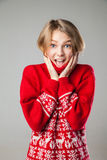 Girl wrapped in a warm knitted sweater. Royalty Free Stock Photos