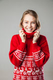Girl wrapped in a warm knitted sweater. Stock Photos