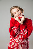 Girl wrapped in a warm knitted sweater. Royalty Free Stock Images