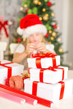 Girl wrapping Christmas gifts Stock Photos