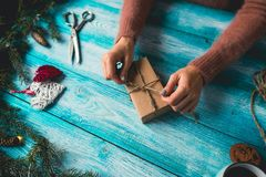 Girl wrapping Christmas Gifts Royalty Free Stock Photos